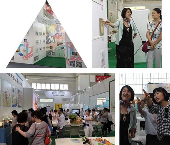 中国数字图书馆副总裁刘小青带领到场师生参观首届中图绘本展